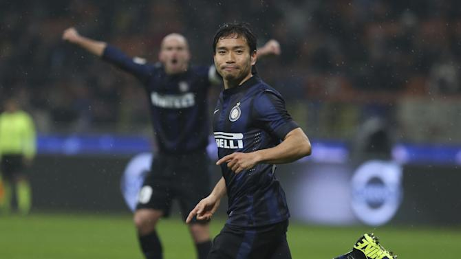 Inter Milan defender Yuto Nagatomo, of Japan, celebrates after scoring during a Serie A soccer match between Inter Milan and Chievo, at the San Siro stadium in Milan, Italy, Monday, Jan. 13, 2014