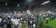 Juventus supporters celebrate on May 6, at the end of their Italian Serie A match against Cagliari at the Nereo Rocco stadium in Trieste. Juventus won the match 2-0 to win the Italian championship