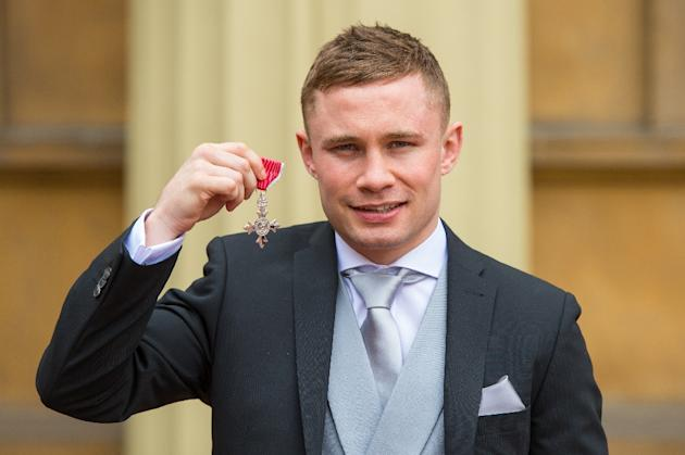 Carl Frampton, pictured with his MBE, has become the first boxer from Northern Ireland to win titles in two divisions after beating Mexico's Leo Santa Cruz to claim the WBA featherweight crown