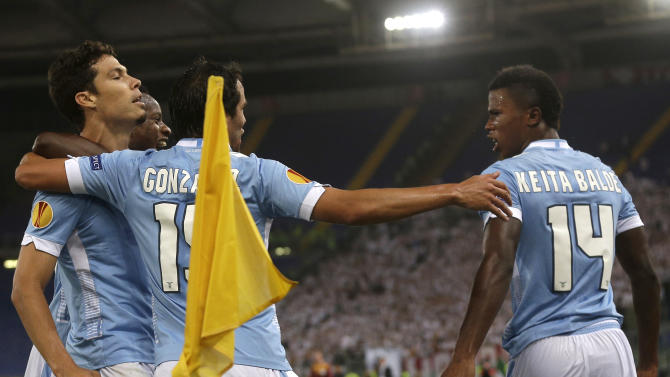 Lazio midfielder Andreson Hernanes of Brazil, left, celebrates with teammates after scoring during an Europa League, Group J, first leg, soccer match between Lazio and Legia Warsaw, in Rome's Olympic Stadium, Thursday, Sept. 19, 2013