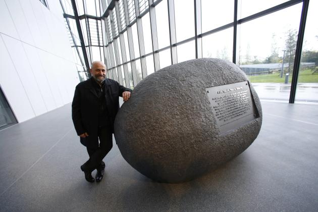 Bulgarian artist Solakov poses next to his sculpture 'The Stone' displayed inside new headquarters of ECB in Frankfurt