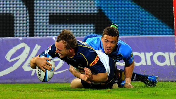 Australia's ACT Brumbies fullback Jesse Mogg scores a try agaisnt South-Africa's Northern Bulls during the Super 15 Rugby union match between Northern Bulls and ACT Brumbies at the Loftus Versfeld stadium in Pretoria , on April 21, 2012. AFP PHOTO / ALEXANDER JOE (Photo credit should read ALEXANDER JOE/AFP/Getty Images)