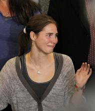 Amanda Knox waves to supporters after arriving in Seattle following her release from custody in Italy, on October 4, 2011. Knox and her Italian former boyfriend Raffaele Sollecito were originally sentenced to 26 and 25 years in prison for killing and sexually assaulting Meredith Kercher in 2007, but were acquitted on appeal after four years in prison.