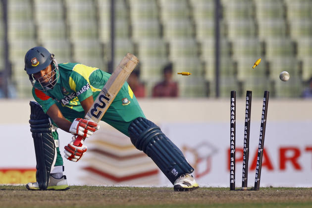 Bangladesh's Sohag Gazi is bowled out by Sri Lanka's Thisara Perera during the third one day international cricket match against Sri Lanka in Dhaka, Bangladesh, Saturday, Feb. 22, 2014. (AP Photo/
