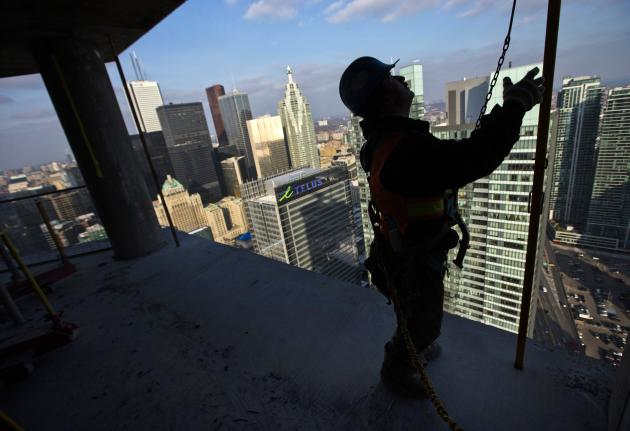"A construction worker stands at the ""ICE Condominiums"" development site by Cadillac Fairview and Lanterra Developments in Toronto in this December 14, 2012 file photo. A 2013 survey of 2,000 people for Bank of Montreal found that 27 percent of first-time buyers in Canada expect their parents or other family members to help them purchase a house. That young adults need help with a first home should come as no surprise. Home prices in Canada hit record highs in late 2013, according to the Teranet-National Bank house price index. Industry data showed the average home price nearing C$400,000 ($358,800) in December. That's up 10 percent from a year earlier and 84 percent from December 2003, when the average price was C$211,768. To match Feature CANADA-ECONOMY/HOUSING REUTERS/Mark Blinch/Files (CANADA - Tags: BUSINESS CONSTRUCTION EMPLOYMENT REAL ESTATE)"