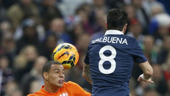 Netherlands' Van Der Wiel challenges France's Valbuena during their international friendly soccer match at the Stade de France in Saint-Denis