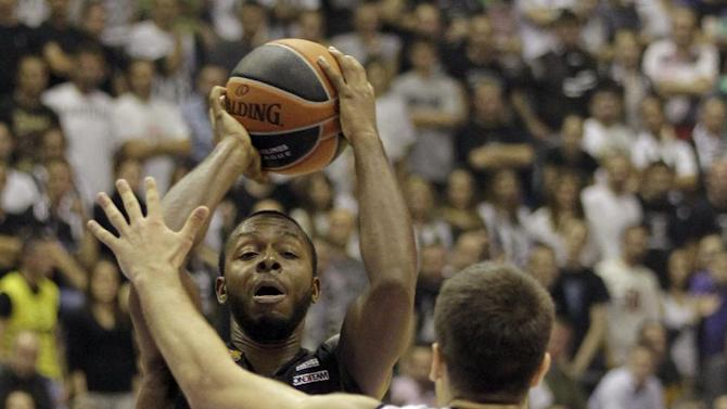 Jacob Pullen of FC Barcelona, left, scores past Mihajilo Andric of Partizan NIS Belgrade during their Round 6, Group A, Euroleague basketball match in Belgrade, Serbia, Thursday, Nov. 21, 2013
