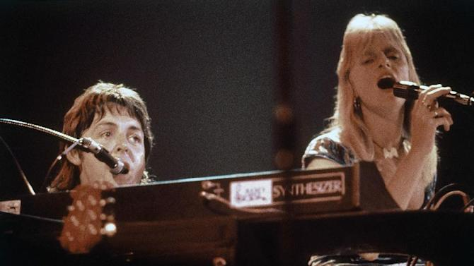 "FILE - This is a May 24, 1976 file photo of  Ex-Beatle Paul McCartney with his wife Linda  as they perform  in the band Wings, at Madison Square Garden, New York.   A 70-year-old song is giving the BBC a headache, as it decides whether to play ""Ding Dong! The Witch is Dead"" _ a song from the ""Wizard of Oz"" being driven up the charts by opponents of Margaret Thatcher as a mocking memorial to the late prime minister,  It's not the first time Britain's national broadcaster has been caught in a bind about whether to ban a song on grounds of language, politics, or taste.  And the broadcaster  nicknamed ""Auntie"" for its ""we-know-what's-good-for-you"" attitude  usually comes under fire, whatever it does.  Paul McCartney and the band Wings had their song ""Give Ireland back to the Irish""  banned by the BBC.  (AP Photo. File)"