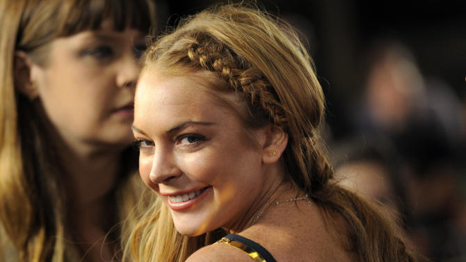 "Lindsay Lohan, a cast member in ""Scary Movie V,"" turns back for photographers at the Los Angeles premiere of the film at the Cinerama Dome on Thursday, April 11, 2013 in Los Angeles. (Photo by Chris Pizzello/Invision/AP)"