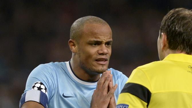Manchester City's Vincent Kompany reacts to the referee after Martin Demichelis was sent off during their Champions League round of 16 first leg soccer match against Barcelona at the Etihad Stadium in Manchester