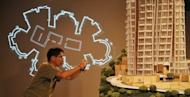 A man takes a photo of a model of Opus Hong Kong at a Frank Gehry exhibition in Hong Kong in 2011. The price for the unit, which takes up the entire 8th floor of the 12-storey building, is believed to be Asia's most expensive apartment, reports say