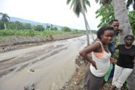 Haitians view damage done by torrential rains brought by Hurricane Sandy in the Nippes region of Haiti on November 17. Hurricane Sandy, the deadly storm that slammed into New York and New Jersey in October, tore through the Caribbean long before reaching America -- and in Haiti, many still await help