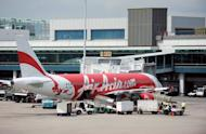 An AirAsia passenger plane is parked on the tarmac of the Changi International Airport in Singapore on July 12, 2012. AirAsia, Asia's largest low-cost carrier, has scrapped plans for a Singapore joint venture due to high operating costs and lack of domestic market potential in the island republic