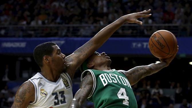 Boston Celtics' Thomas is fouled by Real Madrid's Thompkins during their NBA Global Games friendly basketball game in Madrid