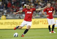 Manchester United's Dimitar Berbatov shoots the ball during the MTN Football Invitational match against Amazulu at the Moses-Mabhida Stadium in Durban. Manchester United started a six-game pre-season world tour with a 1-0 win over AmaZulu