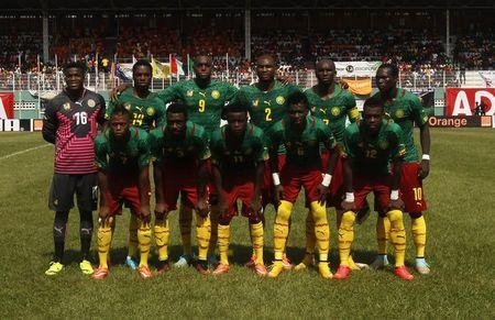 Cameroon's players pose for a team photo before their African Nations Cup qualifying soccer match against Ivory Coast at the Felix Houphouet Boigny stadium in Abidjan