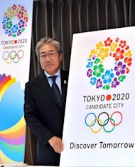 """Tsunekazu Takeda, president of the Tokyo 2020 bid committee, presents its slogan """"Discover Tomorrow"""" and its logo in Tokyo last week. Tokyo, the only one of the three to have previously hosted the Games back in 1964, Istanbul and Madrid will learn their fate in Buenos Aires on September 13 next year when International Olympic Committee members vote"""
