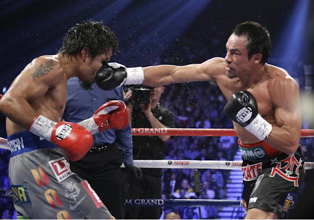 Juan Manuel Marquez, from Mexico, right, lands a right to the head of Manny Pacquiao, from the Philippines, during their WBO world welterweight  fight Saturday, Dec. 8, 2012, in Las Vegas. Marquez won