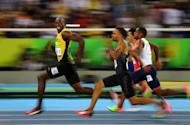 Usain Bolt of Jamaica smiles as he looks back at his competition, whilst winning the 100-meter semi-final sprint, at the 2016 Olympics in Rio de Janeiro, Brazil. REUTERS/Kai Pfaffenbach