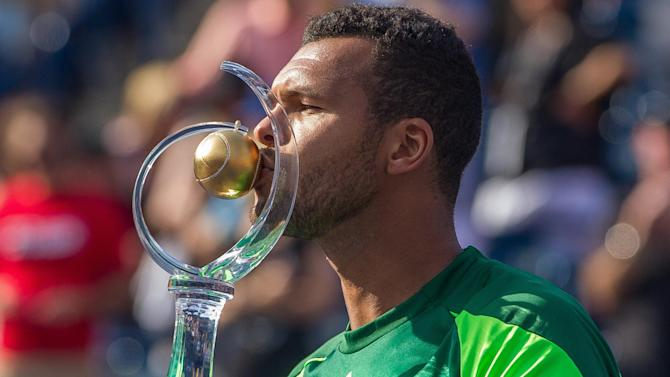 Tennis - Tsonga caps week of upsets with win over Federer and title