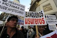 A demonstration against banks in Madrid on Monday. Spain's public debt soared to a record 68.5 percent of economic output at the end of 2011, Bank of Spain figures showed Friday.