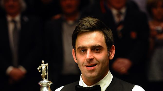 Ronnie O'Sullivan of England holds his trophy as he celebrates beating Ali Carter of England 18-11 in the World Championship Snooker final at the Crucible Theatre in Sheffield, England on May 7, 2012.   AFP PHOTO/ PAUL ELLISPAUL ELLIS/AFP/GettyImages