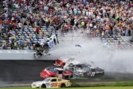 Dozens of fans were injured when this crash sent Kyle Larson's car airborne and debris flew into the stands at the end of the NASCAR Nationwide Series season-opener on February 23, 2013. Joie Chitwood, president of Daytona International Speedway, said 14 injured fans had been transported from the circuit for treatment at local hospitals and 14 more were treated at the track