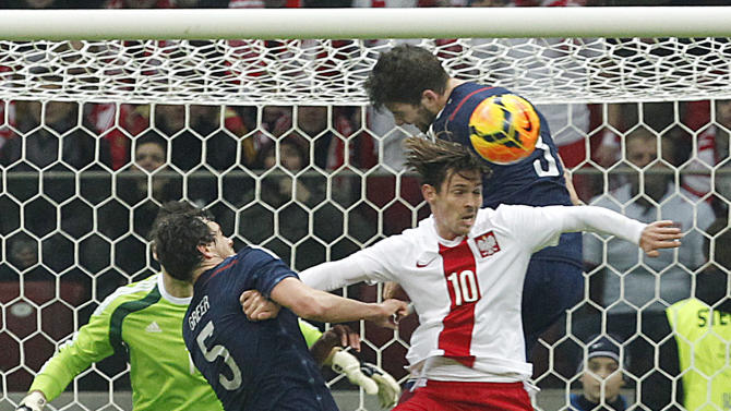 Poland's Ludovic Obraniak, front , and  Scotland's Gordon Greer , left, and Charlie Mulgrew,top, challenge for the ball during a friendly soccer match between Poland and Scotland in Warsaw, Wednesday March 5, 2014