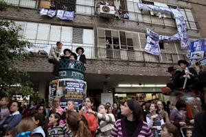 Ultra-Orthodox Jews take part in a rally to show support…