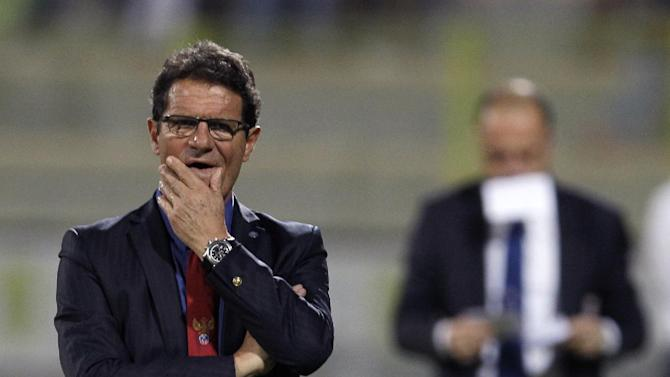 Russia's coach Fabio Capello watches his players during a friendly match with Serbia in Dubai, United Arab Emirates, Friday Nov. 15, 2013