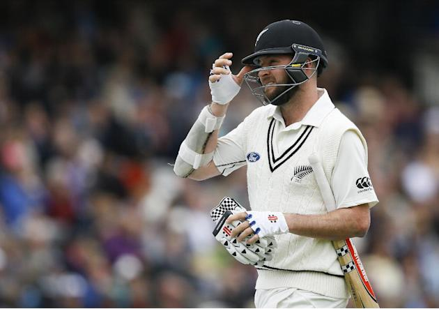 New Zealand's Mark Craig leaves the pitch, bowled lbw for 0 by England's Moeen Ali during the third day of the first Test match between England and New Zealand at Lord's cricket ground in