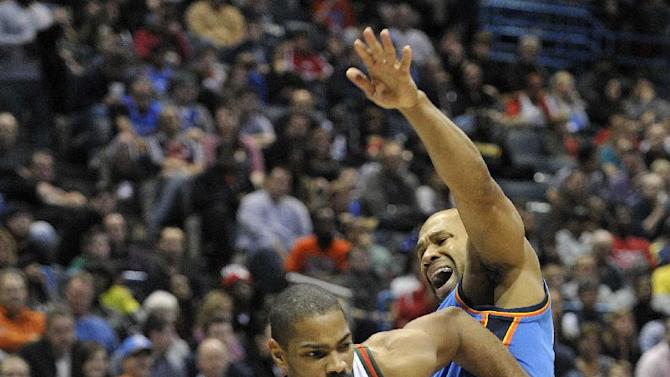 Milwaukee Bucks' Gary Neal (12) drives around the Oklahoma City Thunder's Derek Fisher during the second half of an NBA basketball game Saturday, Nov. 16, 2013, in Milwaukee. The Thunder defeated the Bucks 92-79