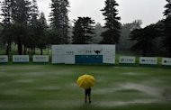 Thunderstorms force the suspension of play during round two of the Yeangder Tournament Players Championship at Linkou lnternational Golf and Country Club in Taipei. Heavy rains forced organisers to abandon the second round of the Yeangder Tournament Players Championship with first round leader Filipino Angelo Que remaining three shots clear