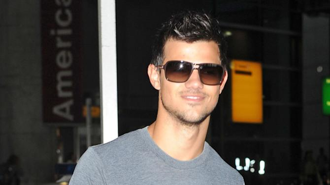 Taylor Lautner arriving at JFK airport in NYC