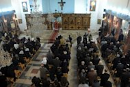 Syrians attend Christmas eve mass at the Mar Elias (St. Elijah) Christian Orthodox church in Bab Tuma, a predominantly Christian quarter of Damascus, on December 24, 2012. With ongoing fighting between Syrian government troops and rebel forces in areas of the Syrian capital, Christians in this diocese are attending church early.