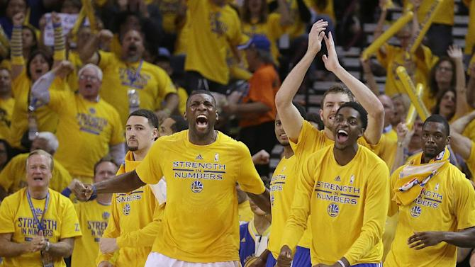 Golden State Warriors players react during the second half of Game 5 of the NBA basketball Western Conference finals against the Houston Rockets in Oakland, Calif., Wednesday, May 27, 2015. (AP Photo/Ben Margot)