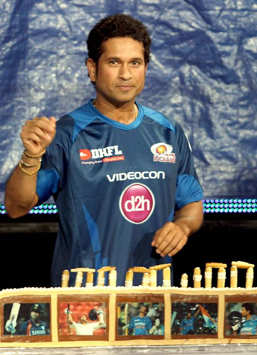 Sachin Tendulkar poses with his birthday cake at the Eden Gardens
