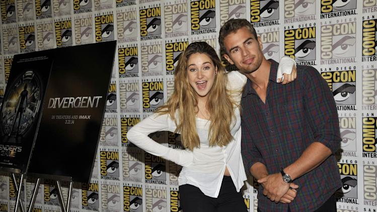 "Shailene Woodley, left, and Theo James attend the ""Divergent"" press line on Day 2 of Comic-Con International on Thursday, July 18, 2013 in San Diego, Calif. (Photo by Chris Pizzello/Invision/AP)"