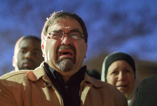 Namee Barakat, father of shooting victim Deah Shaddy Barakat, cries as a video is played during a vigil in Chapel Hill