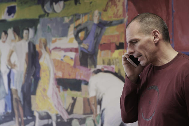 Greece's Finance Minister Yanis Varoufakis speaks on his phone at his office, in central Athens, on Saturday, Feb. 28, 2015. In an interview with the Associated Press Saturday, Varoufakis said tha