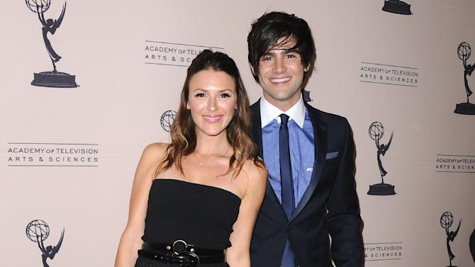 FILE - In this Thursday, June 13, 2013 photo, Elizabeth Hendrickson, left, and Max Ehrich arrive at the 40th Annual Daytime Emmy Awards nominee reception at the Montage Beverly Hills, in Beverly Hills, Calif. The 40th Annual Daytime Emmy Awards are on Sunday, June 16, 2013, in Beverly Hills, Calif. (Photo by Scott Kirkland/Invision/AP, File)