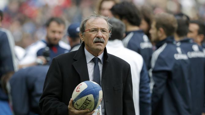 Italy's rugby team coach Jacques Brunel holds a ball before the start of their Six Nations rugby union match against France at the Stade de France in Saint-Denis