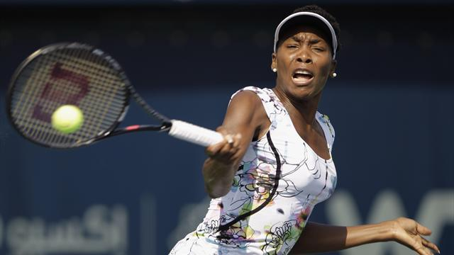 Tennis - Venus battles through Charleston epic