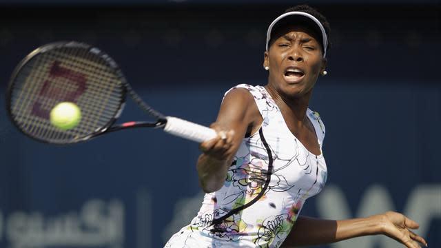 Tennis - Venus battles through Charleston epic