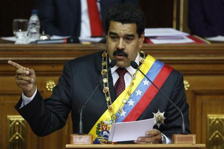 Venezuelan President Nicolas Maduro addresses lawmakers during the presentation of his annual state of the nation at the National Assembly in Caracas January 15, 2014. REUTERS/Carlos Garcia Rawlins