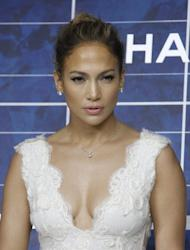 """FILE - In this Oct. 2, 2012 file photo, Jennifer Lopez arrives for the presentation of Chanel's ready-to-wear Spring-Summer 2013 collection in Paris. Lopez has launched her """"J. Lo's Christmas Gift"""" drive, asking fans to donate to her three favorite charities (the Boys & Girls Club, the Children's Hospital of Los Angeles and the American Red Cross). In exchange, she'll give someone two tickets to the last show of her """"Dance Again"""" world tour in Puerto Rico on Saturday, Dec. 22, 2012. (AP Photo/Thibault Camus, File)"""