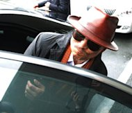 Kenichi Shinoda, boss of Japan's largest yakuza gang, the Yamaguchi-gumi, gets into a car on April 9, 2011 after his release from a Tokyo prison