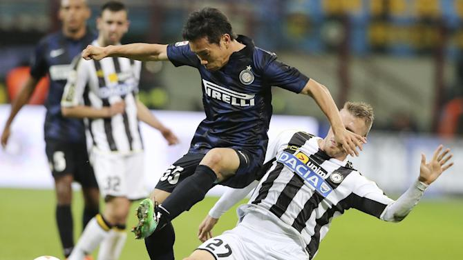 Inter Milan defender Yuto Nagatomo, left, of Japan, is tackled by Udinese defender Silvan Widmer, of Switzerland, during the Serie A soccer match between Inter Milan and Udinese at the San Siro stadium in Milan, Italy, Thursday, March 27, 2014