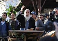 A Turkish man speaks to a crowd about doomsday in Sirince, a village in western Turkey, on December 21, 2012. As the village of Sirince waited for what some say is an apocalypse from which the tiny Turkish hamlet will be spared, its streets were teeming not with doomsayers but a hoard of disappointed journalists.