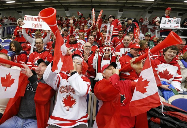 Canadian fans cheer while watching Canada. REUTERS/Alexander Demianchuk